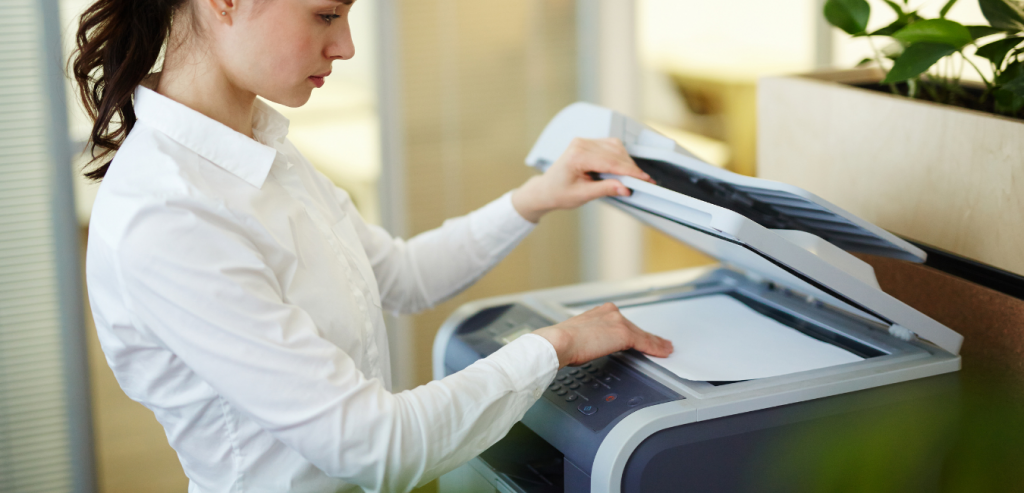 Lady in office using photocopier
